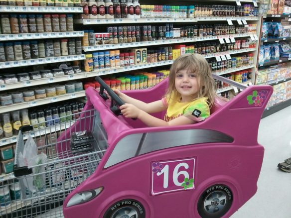 Target carts are so big and cumbersome.  I prefer the ones at HyVee!  So does she because they have PINK racecar carts!