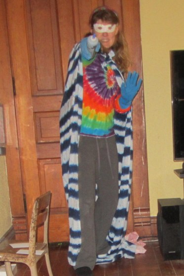 Protecting the earth from evil by dying them hideous shades of tie-dye!  Look up in the sky, it's a peacock, it's a rainbow, it's TIE-DYE GIRL!