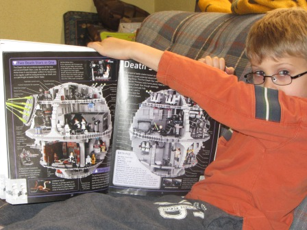 "The Professor showing me some of the cool stuff in the ""Lego Star Wars Visual Dictionary""."