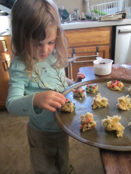 Princess Christmas takes great care to add chocolate chips to the cookies.