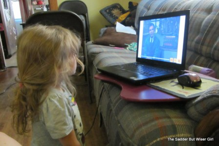 Ok, she's not blogging.  She's watching Mr Rogers.  Close enough?