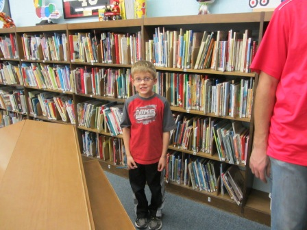 At Open House he shows us his favorite part of the school-the library, of course!