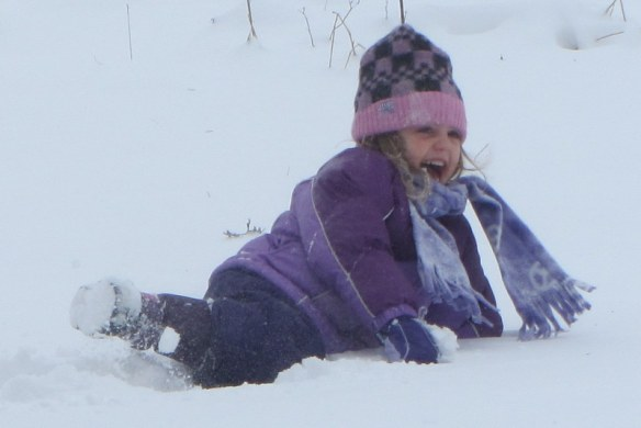 This was when the snow first fell.  You can tell this because she looks like she is actually having fun.