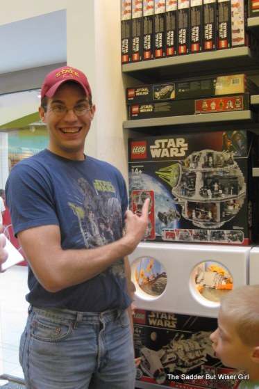 Evil Genius at the Lego Store at the Mall of America.  He dreams of a Lego Death Star.  His mean wife keeps telling him no.