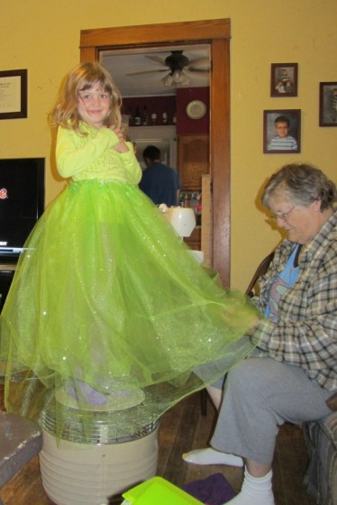 Grandma finishing up The Princess's tutu for her costume.  No hands were sewn in the making of this costume.
