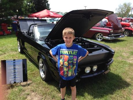 The Professor and his dream car.  It looks like the Batmobile!