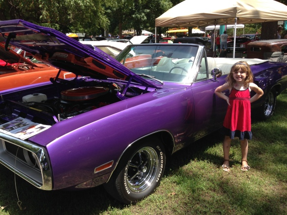 The Princess and her dream car.  A purple convertible.