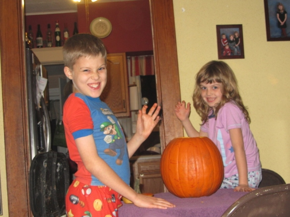 The kids desperately wanted to carve a pumpkin.  Or rather, they wanted someone ELSE to carve it.  Nonsense-dad put them to work pulling out the guts.